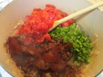 Add the tomatoes, green pepper and spices