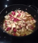 Add wine, pineapple juice, potatoes, salt and pepper.