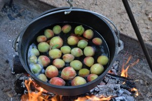 Peaches and cinnamon boiling in a cast iron pot.Peaches and cinnamon boiling in a cast iron pot.